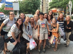 Students from Texas Christian University with The Hutong Education Intern Sunny Gao after a day of commerce in the Central Business District of Beijing.